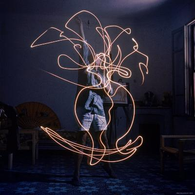 Pablo Picasso Drawing an Image Using a Light Pen-Gjon Mili-Premium Photographic Print