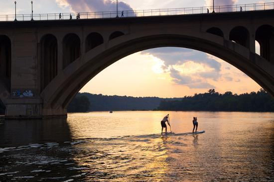 Paddleboarders Glide on the Potomac River under the Key Bridge in Georgetown-Skip Brown-Photographic Print