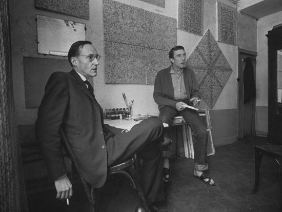 Painter Brion Gysin, Shown W His Paintings in Hotel Room in with Writer William S. Burroughs-Loomis Dean-Photographic Print