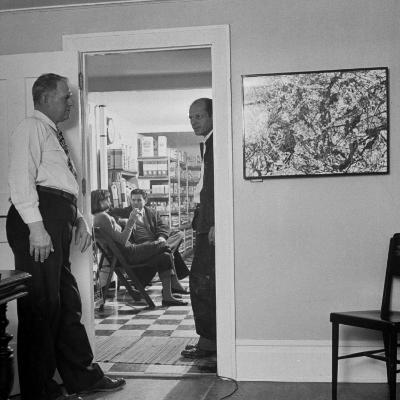 Painter Jackson Pollock Standing in Doorway Near One of His Paintings-Martha Holmes-Premium Photographic Print