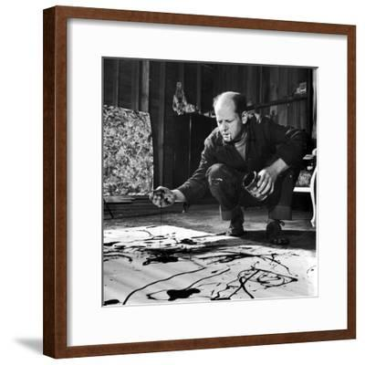 Painter Jackson Pollock Working in His Studio, Cigarette in Mouth, Dropping Paint Onto Canvas-Martha Holmes-Framed Premium Photographic Print