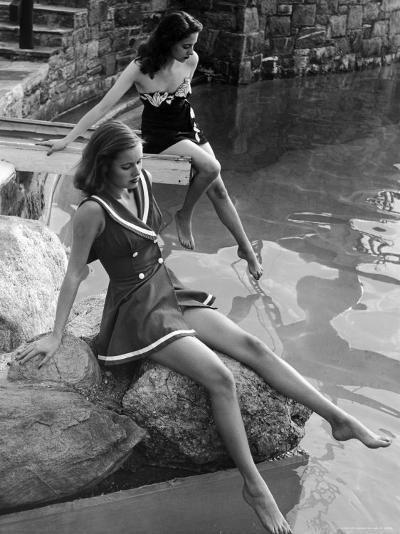Pair of Models Showing Off New Bathing Suits on the Banks of the River-Nina Leen-Photographic Print