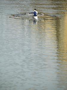 Pair of Rowers Rowing Across Water
