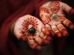 Pakistani Girl Displays Her Hands Painted with Henna Paste