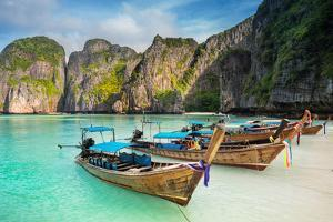 Thailand Sea Beach View Round with Steep Limestone Hills and Traditional Longtail Boats by Pakorn Lopattanakij