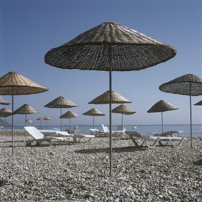 Palapas and Sun Loungers on Beach-Design Pics Inc-Photographic Print