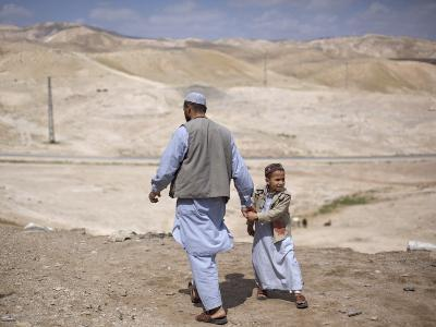 Palestinian Father and Son Walk in Desert During Celebrations Marking the Annual Day of Nebi Musa--Photographic Print