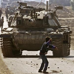 Palestinian Stone Thrower Faces an Israeli Tank, Between Israel and the Gaza Strip