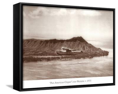 Pan American Clipper over Waikiki, Hawaii, 1935-Clyde Sunderland-Framed Canvas Print