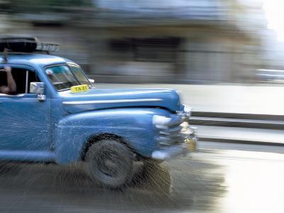 Panned Shot of Old American Car Splashing Through Puddle on Prado, Havana, Cuba, West Indies-Lee Frost-Photographic Print
