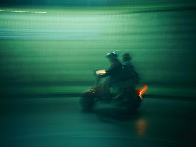 Panned Shot of Two People on a Small Scooter-Michael S^ Lewis-Photographic Print