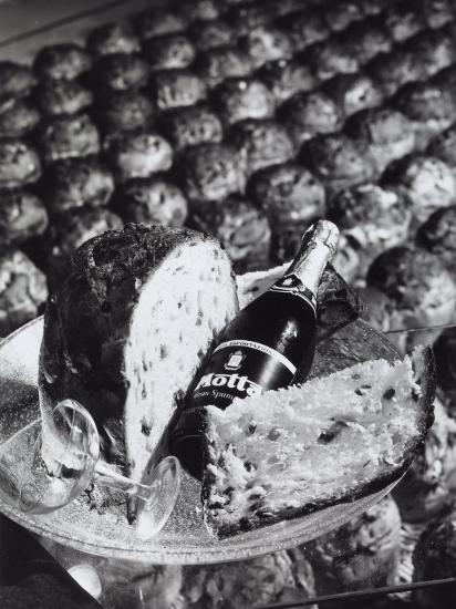 Pannetone, a Bottle of Champagne and a Glass Sitting on a Platter-A^ Villani-Photographic Print
