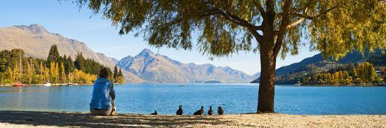 Panorama of Tourist Relaxing by Lake Wakatipu in Autumn at Queenstown, Otago, New Zealand-Matthew Williams-Ellis-Photographic Print