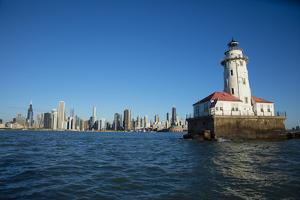 Chicago Harbor Lighthouse with skyscraper in the background, Lake Michigan, Chicago, Cook County... by Panoramic Images