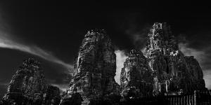 Low angle view of ruins of carved stone faces in temple, Serenity of the Stone Faces, Prasat Bay... by Panoramic Images