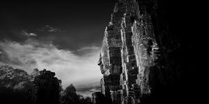 Sunset over a smiling face at temple, Prasat Bayon, Angkor Thom, Siem Reap, Cambodia by Panoramic Images