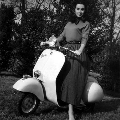 https://imgc.artprintimages.com/img/print/paola-mori-on-a-vespa-during-her-honeymoon-with-orsonwelles-in-south-of-france-may-1955_u-l-pwglur0.jpg?p=0