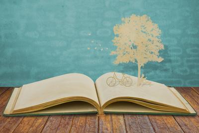 https://imgc.artprintimages.com/img/print/paper-cut-of-children-read-a-book-under-tree-on-old-book_u-l-q1g8uvw0.jpg?p=0