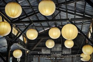 Paper Lanterns Hanging in a Barn in Charleston, SC with Thomas Edison Quote