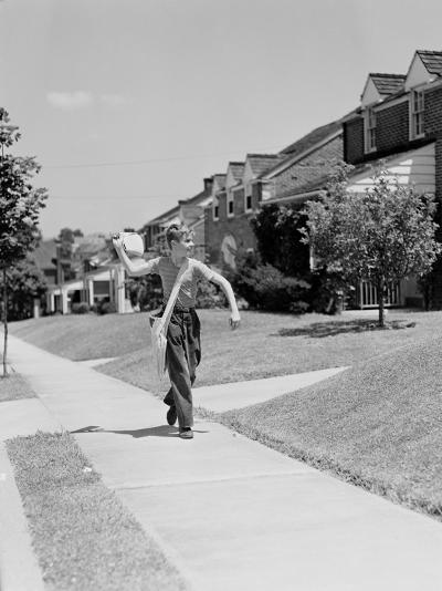 Paperboy Walking Along Suburban Street, Delivering Newspapers-H^ Armstrong Roberts-Photographic Print