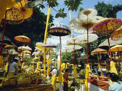 Parasols in Taman Pile Hindu Temple on Koningan Day, Bali, Indonesia-Robert Francis-Photographic Print