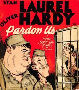 PARDON US, from left: Oliver Hardy, Stan Laurel on window card, 1931.
