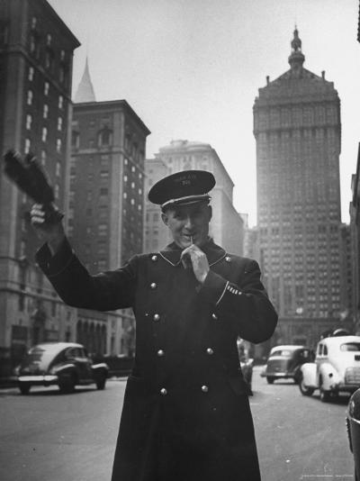 Park Avenue Doorman Using Whistle to Flag Down a Taxi For One of the Residents of His Building-William C^ Shrout-Photographic Print