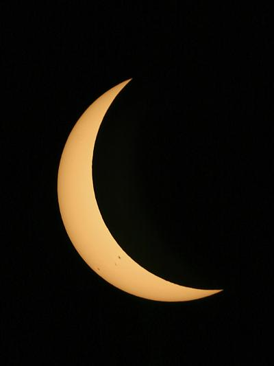 Partial Phase of a Solar Eclipse Photographed Through a Telescope-Babak Tafreshi-Photographic Print