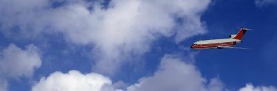 Passenger Jet, Flying, Clouds--Photographic Print