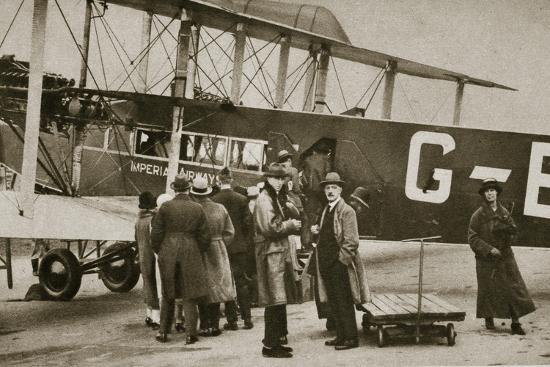 Passengers boarding an Imperial Airways aircraft for a flight to Paris, c1924-c1929 (?)-Unknown-Photographic Print