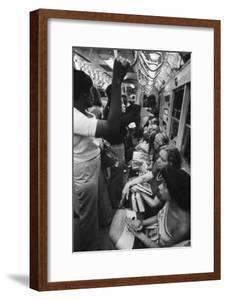 Passengers Commuting on a NYC Lexington Avenue Subway in the 1970s. May 1973