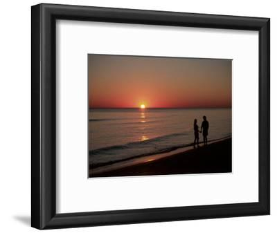 Silhouette of Couple on Beach at Sunset, FL