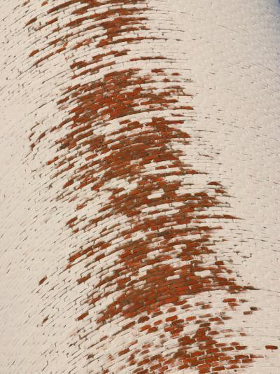 Patches of Snow on Weathered Brick Structure--Photographic Print