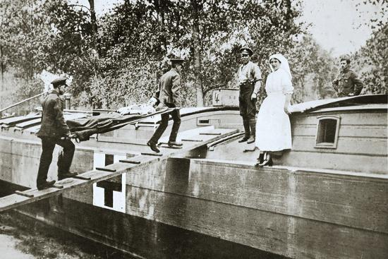 Patients being taken on board a hospital barge, Somme campaign, France, World War I, 1916-Unknown-Photographic Print