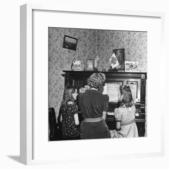 Patricia Colleen Altree Playing the Piano with Her Two Sisters-J. R. Eyerman-Framed Photographic Print