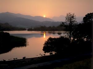 Sunset on Elter Water, Near Ambleside, Lake District National Park, Cumbria, England, UK by Patrick Dieudonne