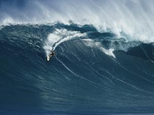 A Surfer Rides a Powerful Wave off the North Shore of Maui Island by Patrick McFeeley