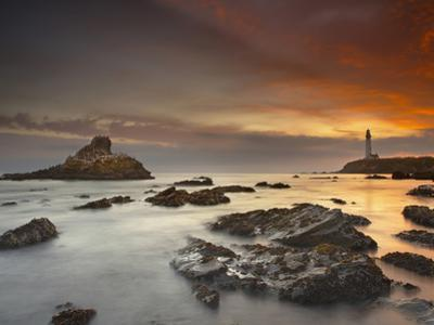A Lighthouse and Wave Action at Sunset on the Rocky Shore Just South of Pigeon Point by Patrick Smith