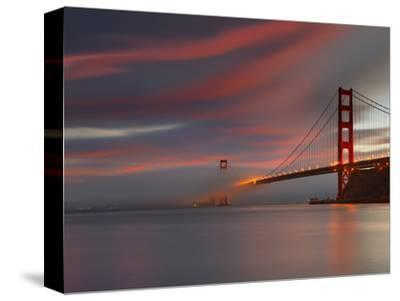 Fog over the Golden Gate Bridge at Sunset, San Francisco, California, USA