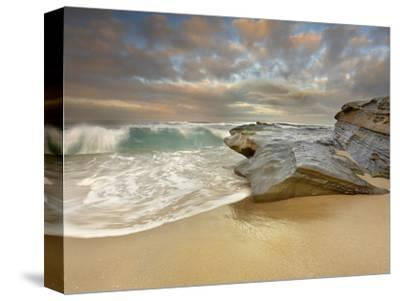 Large Waves Eroding the Sandy Beach and Sandstone Outcrop on the La Jolla, California, USA Shore