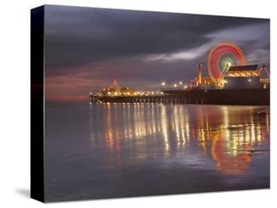 Santa Monica, California, USA Pier at Night, with Lights and Amusement Rides