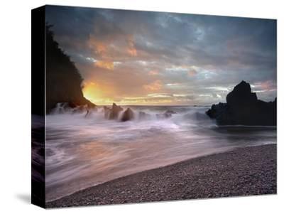 Sunset View of Waves Crashing onto Lava Rocks and the Black Sand Beach Near Hana, Maui, Hawaii