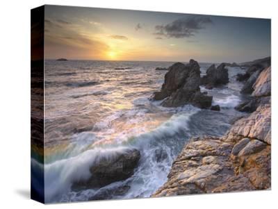 Sunset View of Waves Eroding the Rocky Coastline Near Carmel, Central California, USA