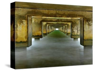 View under the Concrete Pilings of the Pier at Hanalei, Kauai, Hawaii, USA
