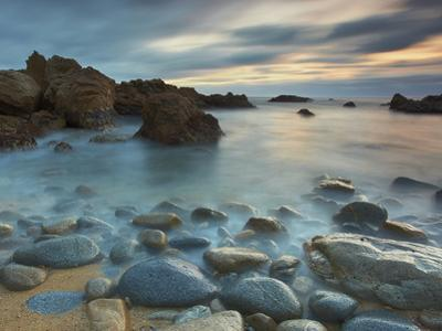 Waves Eroding the Rocks and Cobblestones on the Rocky Big Sur Coast of Central California, USA by Patrick Smith