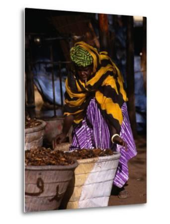 Local Woman Setting Up to Sell Dried Fish in Mopti Harbour, Mopti, Mali