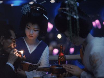 https://imgc.artprintimages.com/img/print/patron-of-nightclub-uruwashi-having-his-cigarette-lit-by-geisha_u-l-p3oa1h0.jpg?p=0