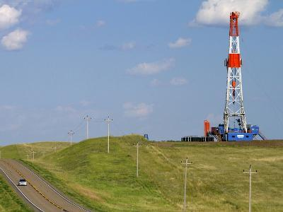 Patterson Uti Oil Drilling Rig Along Highway 200 West of Killdeer, North Dakota, USA-David R^ Frazier-Photographic Print