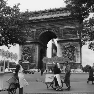 Selling Ice-Cream, Arc de Triomphe, Paris, c1950 by Paul Almasy
