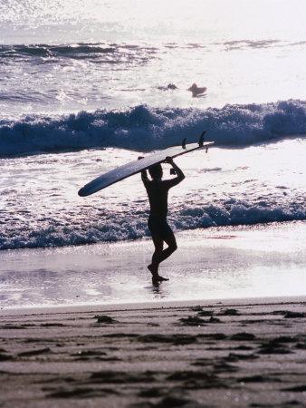 Longboarder Walking on Beach, Indonesia